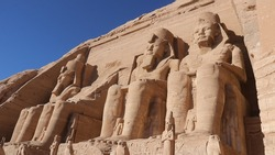 Four colossal statues of Ramesses II guard the entrance to his famous rock-cut temple at Abu Simbel, to honor himself as pharaoh.