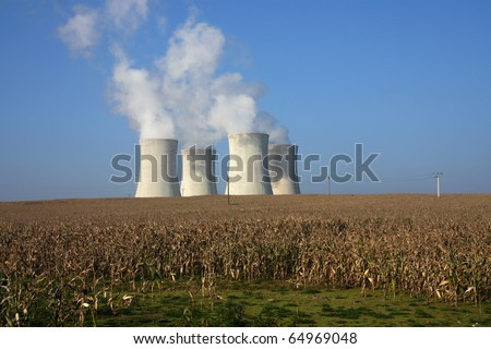 four cooling towers in corn agriculture field