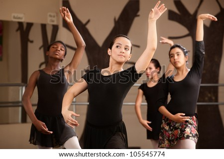 Four cute Black and Latina dance students rehearsing