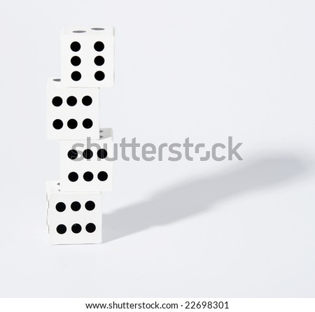 Four dices with number six on top of eachother