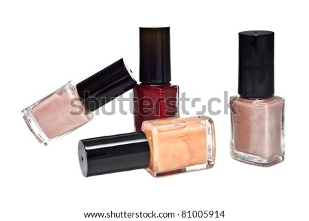 Four different bottles of nail polish isolated on white
