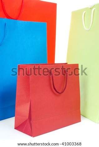 Four different color gift bags on white background
