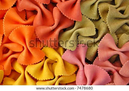 Four different flavors of farfalle bow tie pasta. Italian food background detail.