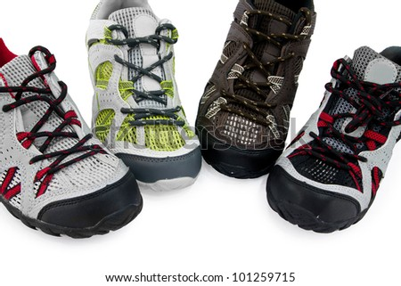 Four different Sport shoes in white background