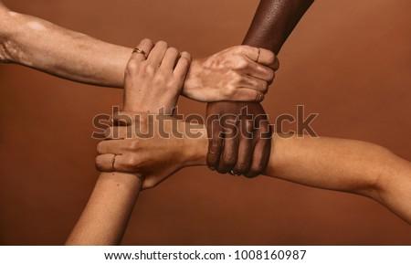 four diverse women holding each ...