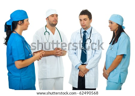 Four doctors team having a sad discussion and thinking together  at solutions isolated on white background