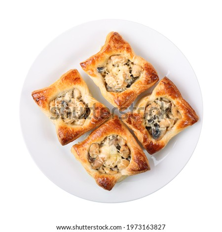four edible puff pastry baskets with Julien on a white round dish isolated over white background. top view. ストックフォト ©