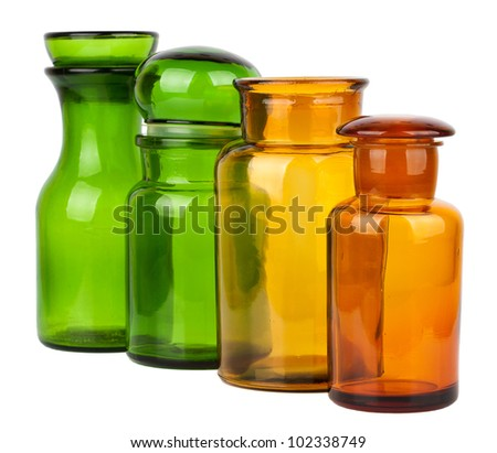Four empty glass jars isolated on white background