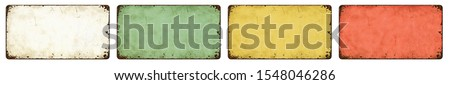 Four empty vintage tin signs on a white background Stockfoto ©