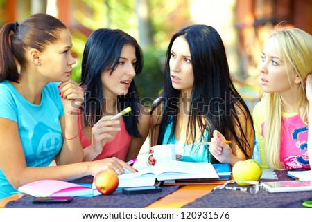 four female student studying for the exam, outdoors
