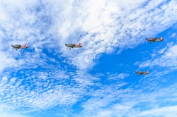 four fig wing airplanes in the blue sky and white cloud