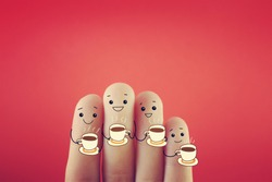 Four fingers decorated as four person drinking hot drink.