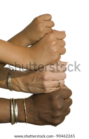 four fists of four people of different ages on a white background