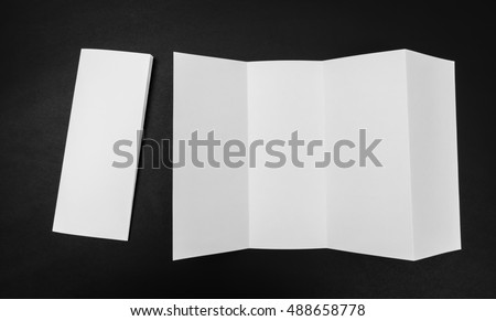 Four - fold white template paper on black background #488658778