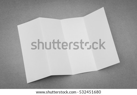 Four - fold white template paper on gray background #532451680