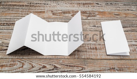 Four - fold white template paper on wood texture #554584192