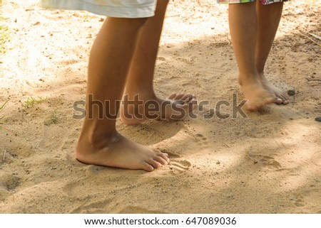 four free foot of children standing on soil floor , concept ground background #647089036