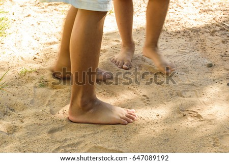 four free foot of children standing on soil floor , concept ground background #647089192