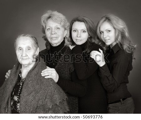 Four generations of women in a family on black