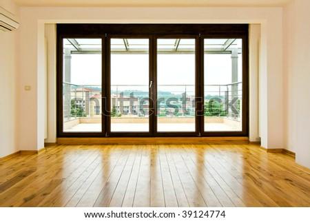 Four glass doors in empty living room