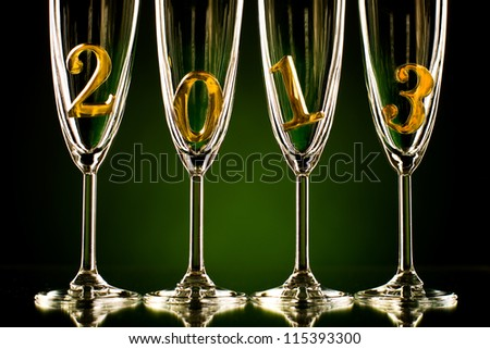four glass goblet for champagne with  numeral 2013,  beautiful celebrations  New Year concept photo