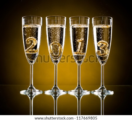 four glass goblet with champagne and  numeral 2013,  beautiful celebrations  New Year concept photo