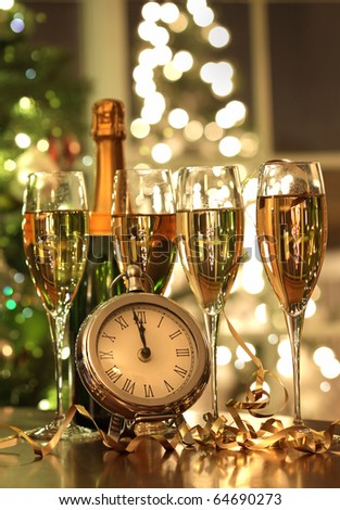Four glasses of champagne ready for the countdown to the New Year