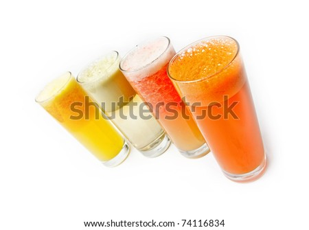 Four  glasses of different fresh juice,  over white (orange carrot apple grapefruit)