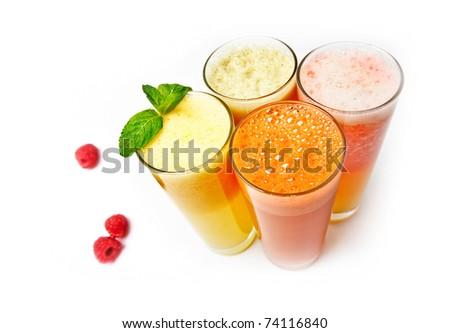 Four  glasses of different fresh juice over white, (orange carrot apple grapefruit)