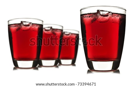 Four glasses of red fruit juice with ice on white background