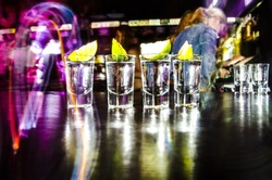 four glasses with Lim on the bar at a nightclub