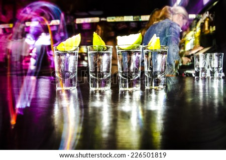 four glasses with Lim on the bar at a nightclub Сток-фото ©