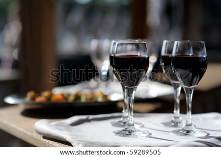 Four glasses with red wine on a sun