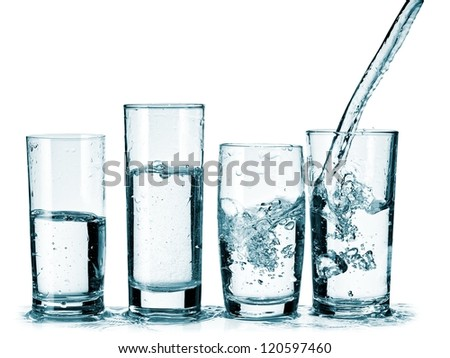 Four glasses with water pouring