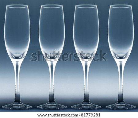 four goblets with gray background