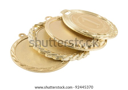 Four gold medals isolated on white background