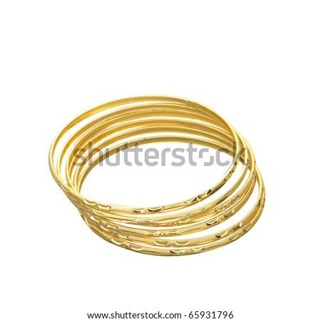 Four golden bracelets stacked together.