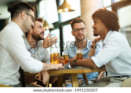 four guys in a coffee shop talking about basketball