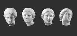 Four gypsum copy of ancient statue Venus head isolated on black background. Plaster sculpture woman face.