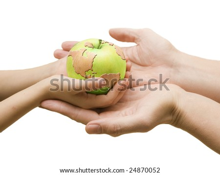 Four hands and world drawn on green apple