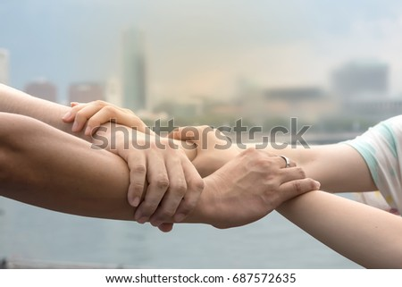 Four Hands Hold Together Like Square Shape Mean Be In Harmony