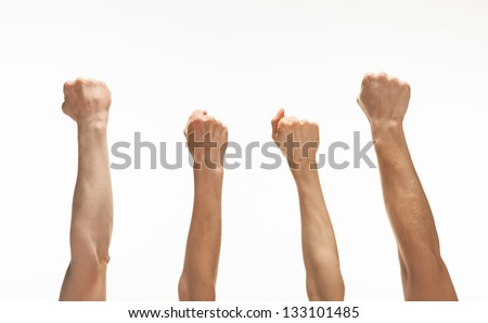 Four hands showing fists raised up, white background