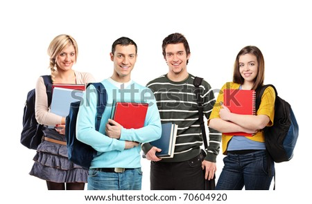 Four happy students posing with books isolated on white background