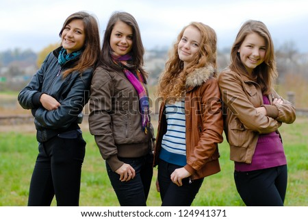Four happy teenage girls friends