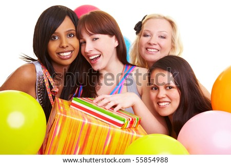 Four happy young women with gifts and balloons - stock photo