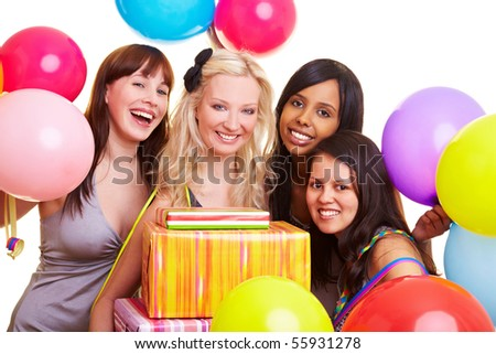 Four happy young women with many colorful balloons