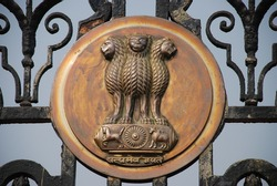 Four headed lion - emblem of India displaying on the gate of Rastrapati Bavan in New Delhi