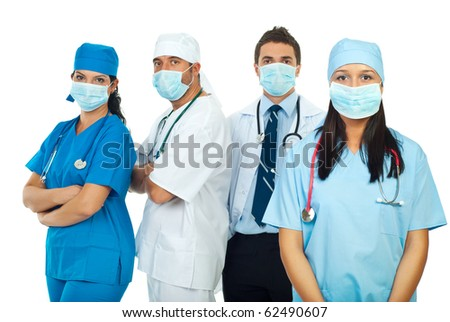 Four healthcare workers team wearing protective masks isolated on white background