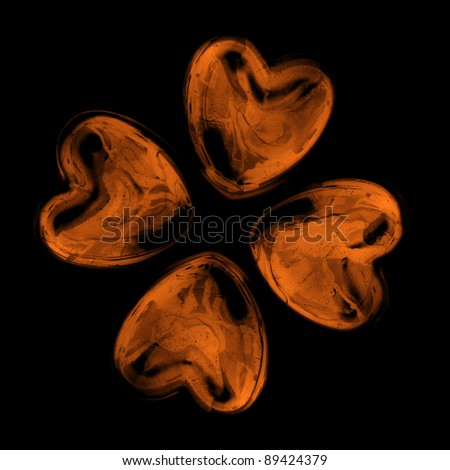 four hearts isolated on black