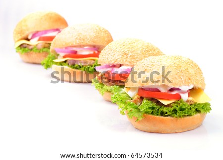 four homemade hamburgers isolated on white background